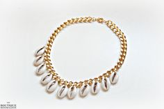 Cowrie Shells Statement Necklace by BoutiqueMinimaliste on Etsy, $54.00