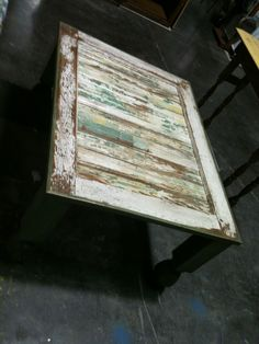 cool aged table. bed frame/old door?