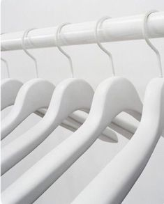 Chic, minimalist white hangers on a white clothing rail. Photograph by Edwin Himself. All White, Pure White, Flux Chair, Art Blanc, Hight Light, White Hangers, Blanco White, Mawa Design, Wall Mounted Coat Rack