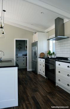 Resene Half Tea on the walls is a nice contrast to crisp Resene White on the ceilings and trims.   picture Jessica Judge.