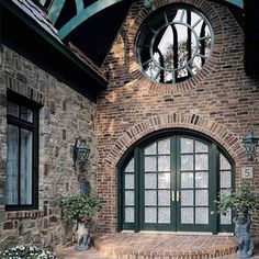 Marvin arched French doors with large circular window above.
