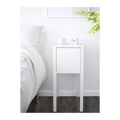 IKEA NORDLI bedside table On the hidden shelf is room for an extension socket for your chargers.