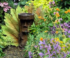 Plant in Layers.  Think of your garden like a cake and create bands of color that run horizontally. Layered plantings such as the garden you see here are wonderful for adding depth to your yard. In this garden, lacecap hydrangeas create a soft pink and blue strip. Underneath is a swath of oranges and yellows, and a lovely band of lavender provides a base.