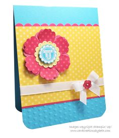 bright and beautiful handmade card ...  turquoise, hot pink and bright yellow ... luv the sentiment as an embossed circle in the middle of the Blossom punch flower ... makes me smile!! ... Stampin' Up!