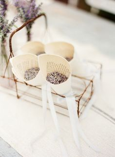 "sweet idea- use lavender buds as ""rice"" at a wedding. --Love lavender and also love the idea of having paper holders from old books :)"