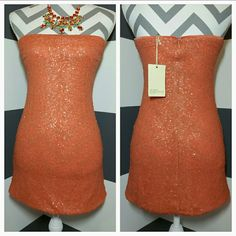 "🆕 Sassy Sequin dress NWT Brand new with tags Grab this fabulous peachy orange sequin dress for your spring/summer wardrobe!! Dress it up with statement jewelry and heels or make it casual with a blazer, turquoise jewelry and comfy shoes. This strapless dress is covered in small sequins.  Size small. Material 100% polyester Rubbed edging runs along bust inside to keep dress up. Pic#4 Bust seam to seam approx 15"" Strapless style Length 23.5"" Dresses Strapless"