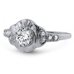 """Ethical Fine Jewelry  The Tildie Ring - """"A darling scalloped profile makes this ring truly remarkable, further enhanced by engraved detail on both the top of the setting and on the band. An old mine cut center twinkles at the ring's center, while eight diamond accents add luxurious sparkle (approx. 0.51 ct. tw.)."""" $2,250"""