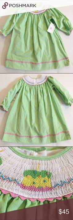 "Marmellata green embroidered birthday dress NWT -- Marmellata green smocked and embroidered corduroy birthday dress. Buttons at back. Embroidered birthday cakes and pink ""rick rack"" ribbon trim. Marmellata Dresses Casual"