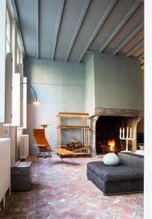 Beautiful brick floors totally make this stunning living room! #livinginstyle