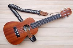 A personal favorite from my Etsy shop https://www.etsy.com/listing/285994519/dark-retro-style-ukulele-strap-3in1