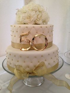 "Like the gold beads on sides but not crazy about ribbon.  Like flowers on top and the ""50"""