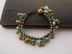 A personal favorite from my Etsy shop https://www.etsy.com/listing/173759827/turquoise-bracelet-brass-bead-handmade