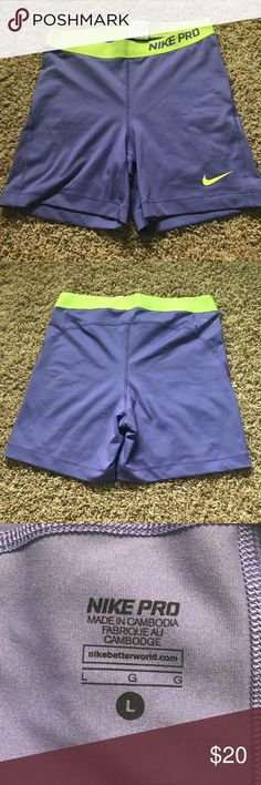 "Nike Pro Purple/Neon Yellow Spandex Nike Pro Spandex with a 4"" inch inseam. Size Adult Large. Only worn once. There is an area with weird stitching (Picture 4), but otherwise these are in amazing condition! Perfect for cheer or volleyball💜💛 Nike Shorts"