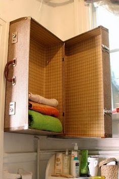 Towel Trunk - wall art and extra storage space in one. You could even add shelves/hooks inside and hang a mirror or picture on the outside.