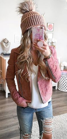 what to wear wiht a pink biker jacket : knit hat white top ripped jeans