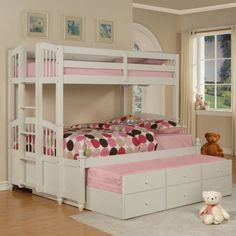 Create the bedroom of your daughter's dreams with the May Twin over Full Bunk Bed. An excellent choice for multi-child rooms and great for slumber parties this lovely twin-over-full bunk bed is constructed of durable and sturdy wood protected by a pure white finish for a charming cheerful flair. Decorative feet round finials and arched headboards and footboards enhance the cozy traditional look. The top bunk features guardrails for added security