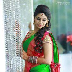 South Indian bride. Gold Indian bridal jewelry.Temple jewelry. Jhumkis Green and red silk kanchipuram sari.Half updo with fresh flowers. Tamil bride. Telugu bride. Kannada bride. Hindu bride. Malayalee bride.Kerala bride.South Indian wedding.