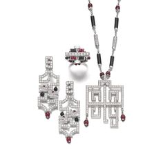 Ruby, diamond and onyx parure, 'Le Baiser du Dragon', Cartier Comprising: a necklace set with polished onyx, ruby beads and brilliant-cut d...