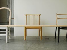 """Bench2 by Jo Nagasaka of Tokyo-based Schemata Architecture Office is made of six chairs and a plank of wood. """"A chair+ a (duck-legged) chair+ a chair+ a chair+ a chair+ a chair ⇒ a bench,"""" explains Nagasaka. The bench was exhibited at the New Tokyo Contemporaries exhibition at the Shin-Marunouchi building in Marunouchi, Tokyo, last"""