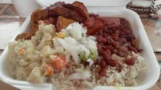 potato salad, pig tail, white rice, red beans, fried plantains & stew chicken
