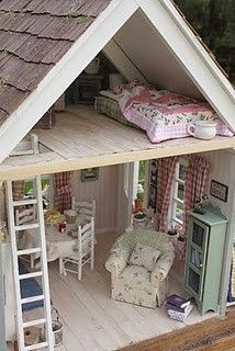 Our mom built and decorated a beautiful dollhouse for me and my sister to play with. <3