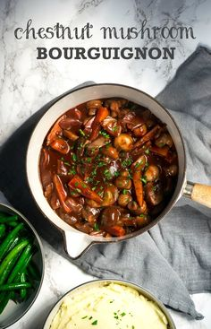 This juicy chestnut mushroom bourguignon in a rich red wine gravy is a hearty vegan comfort food supper with mash and green beans.