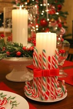 Use a 3x9 candle and plastic candy canes, I used a rubber band (I didn't want it permanent) to hold them in place and used ribbon to hide it.