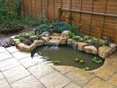 Build a Small Water Feature | Purbeck stone rockery, waterfall and planting added to existing pond ...