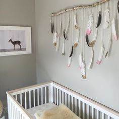 love this dipped feathers decor hanging above our #babyletto Scoot crib... super chic #diy idea! | mama: @mrslizrice