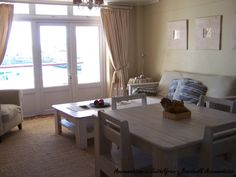 The Boardwalk Accommodation in Gordon's Bay. Accommodation in Gordon's Bay. Cape Town South Africa, Dining Table, Travel, Furniture, Home Decor, Viajes, Decoration Home, Room Decor, Dinner Table