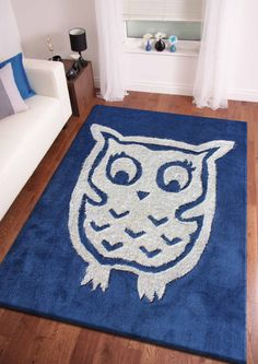4' x 6' ft.  Blue Kids Bedroom Area Rug with Owl Design from Rug Addiction  This rug is perfect for college door room. For your owl lover :)