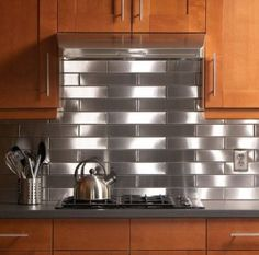 Metal backsplash in kitchens, possible design trend for 2015.