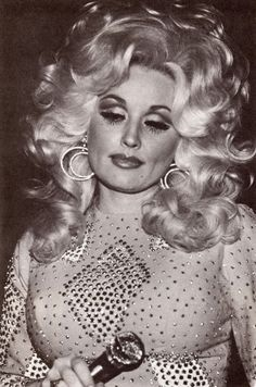 The prettiest, sweetest, singing-songwriting blondes in country music, Dolly Parton.