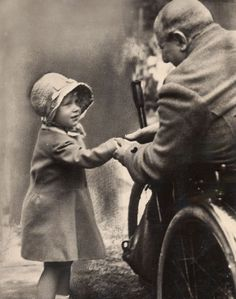 Princess Elizabeth of York with a disabled soldier, 1928.