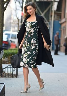 Miranda Kerr stepped out in NYC clad in a cheerful, chic, and decidedly spring-appropriate floral dress, topped.