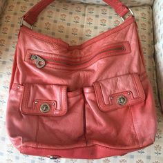 Marc by Marc Jacobs handbag in melon/orange This is a re-posh. Bag is faded in some areas and also has some markings as shown in the pictures. Inside fairly clean as shown. Handle in decent condition. No tears in the leather. Any questions let me know. Offers welcome. Marc by Marc Jacobs Bags Shoulder Bags