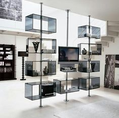 Contemporary TV Stands that Redefine the Living Room is part of Contemporary Living Room TV Stand - While we believe that the couch sets the tone for the style and theme of the living room, it is the entertainment unit or TV Stand that defines the Tv Stand Room Divider, Tv Stand Decor, Room Divider Shelves, Hanging Shelves, Wood Shelves, Glass Shelves, Floating Shelves, Tv Stand Modern Design, Contemporary Tv Stands