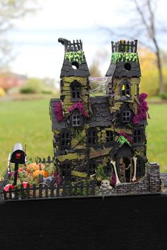 tim holtz vintage village with bungalow and manor house all combined using multiple dies for Halloween Village