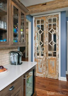 Antique doors imported from Italy were repurposed as pantry doors in this kitchen.