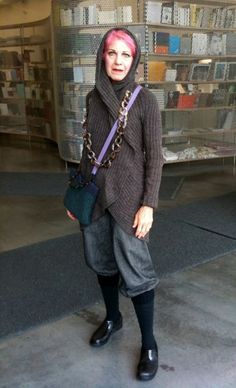 ADVANCED STYLE: simple lines and accessories, muted colors, and personalization-- rolled pants over tights.