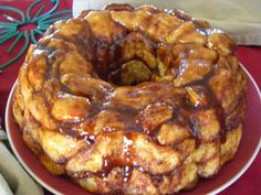 MONKEY BREAD 4 cans refrigerator biscuits (about 40) 1 1/2 tablespoons cinnamon 1/2 cup butter 1 cup white sugar 1 cup brown sugar, packed 1/2 cup pecans, raisins and/or coconut, if desired Cut each biscuit into 4 pieces. Pour sugar and cinnamon into a plastic bag and mix. Add biscuit pieces, several at a time; shake to coat well. Place pieces in a buttered tube or Bundt pan until all are used. Sprinkle layers with nuts, raisins or coconut. Bring brown sugar and butter to a...
