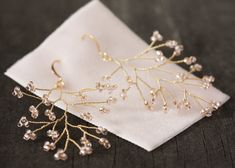 I wrapped gold wire and used these delicate rose gold colored seed beads to create these beautiful branch earrings. They are 2 from the top of