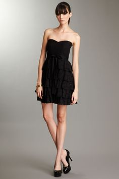 Elegant eyelet little black dress. I'd like to pretend I can pull this off :P