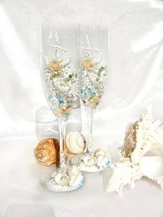 Starfish wedding champagne glasses, beach wedding toasting flutes in white, water blue and green. $57.00, via Etsy.