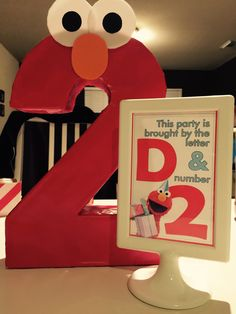 Cardboard number 2 from cereal box wrapped in wrapping paper. Tolsby frame ikea with printed birthday wordings Monster First Birthday, Elmo Birthday, First Birthday Parties, First Birthdays, Sesame Street Party, Sesame Street Birthday, Elmo Party, Number 2