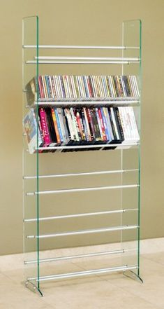 This sleek & contemporary designed glass multimedia rack compliments any room decor. Display your CD/DVD collections in a very unique way. Features: Accommodate 336 CDs or 234 DVDs or 138 VHS or any of the combination; Tempered safety glass panels with beveled edges; 6 fixed metal rod... more details available at https://furniture.bestselleroutlets.com/game-recreation-room-furniture/tv-media-furniture/media-storage/product-review-for-transdeco-glass-multimedia-cd-dvd-rack