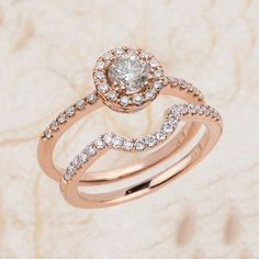 Ladies 14K rose gold diamond engagement ring and band. The center is a 0.40 ct natural round cut diamond. Total diamond weight on the ring is 1.25