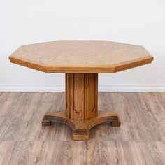This octagon pedestal table is featured in a solid wood with a glossy honey oak finish. This dining table is in great condition with a carved column pedestal base and a large octagon table top. Simple table perfect for causal dining or as a game table! #traditional #tables #diningtable #sandiegovintage #vintagefurniture