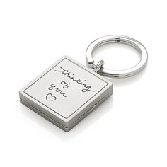"""Keep dear ones near with our charming photo locket keyring. Inscribed with """"thinking of you"""" and a heart, locket opens to two mini picture frames."""