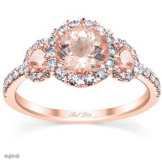 A three stone engagement ring with a halo is an excellent way to highlight the meaning behind this timeless style.  A traditional three stone ring represents the past, present, and future of a relationship and the particular choice of the center stones that represent these aspects can put an interesting spin on your particular relationship's idiosyncrasies.  With morganite stones, it demarks a relationship that embodies unconditional love, compassion, empathy, and patience.  The added detail…